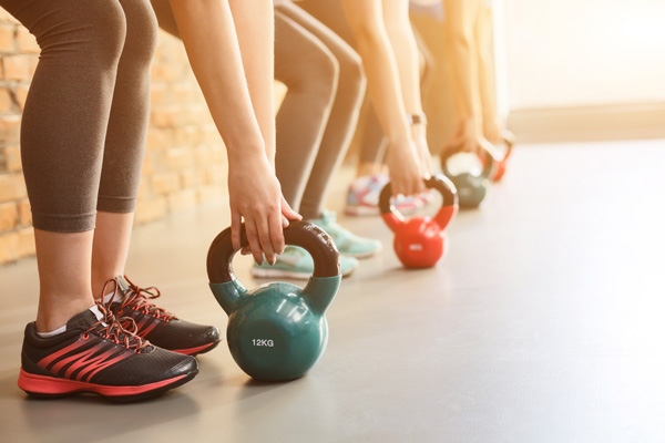 Women working out with kettlebells